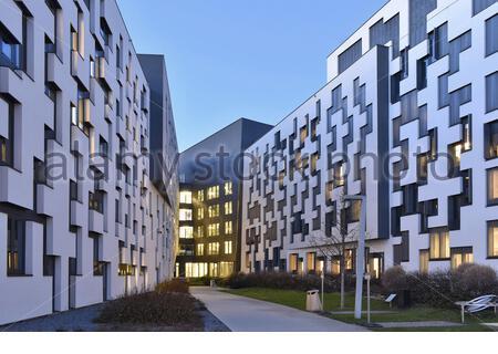 WU Wirtschaftsuniversität Wien (University of Economics and Business) modern campus building at dusk in Vienna Austria - Stock Photo