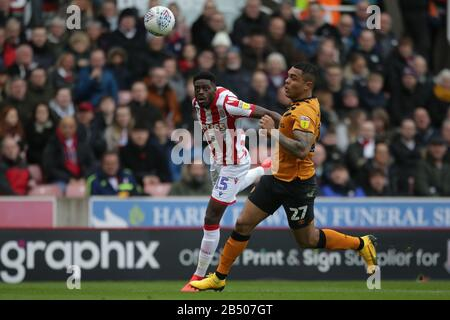 Stoke On Trent, UK. 07th Mar, 2020. Stoke City defender Bruno Martins Indi (15) heads bacl to his goalkeeper as Hull City forward Josh Magennis (27) looks on during the EFL Sky Bet Championship match between Stoke City and Hull City at the bet365 Stadium, Stoke-on-Trent, England on 7 March 2020. Photo by Jurek Biegus. Editorial use only, license required for commercial use. No use in betting, games or a single club/league/player publications. Credit: UK Sports Pics Ltd/Alamy Live News