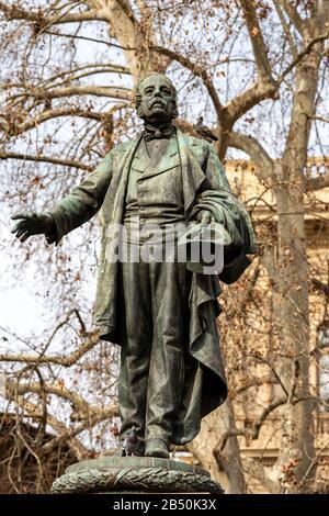 Bronze Statue (1896) of Marco Minghetti (1818-1886), Italian right-wing politician, in Piazza Minghetti, Bologna downtown, Emilia-Romagna, Italy - Stock Photo
