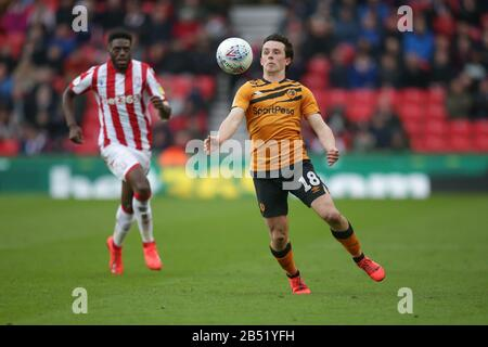 Stoke On Trent, UK. 07th Mar, 2020. Hull City midfielder George Honeyman (18) controls the ball as Stoke City defender Bruno Martins Indi (15) looks on during the EFL Sky Bet Championship match between Stoke City and Hull City at the bet365 Stadium, Stoke-on-Trent, England on 7 March 2020. Photo by Jurek Biegus. Editorial use only, license required for commercial use. No use in betting, games or a single club/league/player publications. Credit: UK Sports Pics Ltd/Alamy Live News
