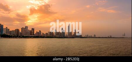Panoramic View of Kuwait city Skyline from the Arabian Gulf Sea at Sunset - Stock Photo