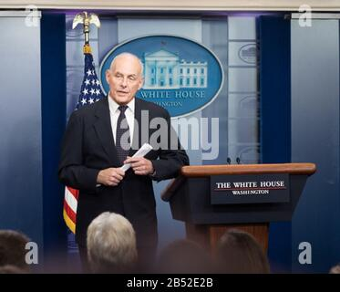 """WASHINGTON, DC -OCTOBER 19: White House Chief of Staff Gen. John Kelly speaks to members of the White House Press Corps, Thursday, Oct. 19, 2017, in the James S. Brady Briefing Room at the White House in Washington, D.C., saying he was """"stunned"""" and """"broken hearted"""" in listening to the criticism directed toward President Donald J. Trump for his phone call to the family of a U.S. Army Sgt. killed recently in Niger. Gen. Kelly also said he felt angry and frustrated at the way the issue has become politicized.  People:  Donald Trump, joined by Vice President Mike Pence - Stock Photo"""