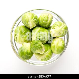 Vegetables for everyone. Brussels sprouts in glass bowl - Stock Photo