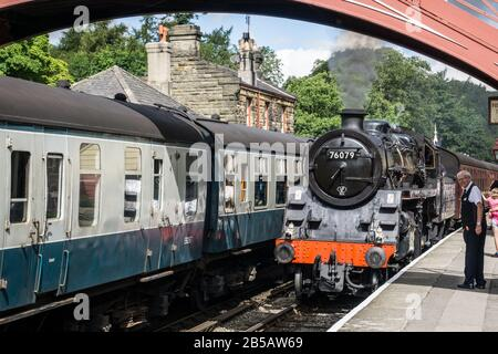 British Rail Standard 4MT steam locomotive No. 76079 at Goathland station on the North Yorkshire Moors Railway. - Stock Photo