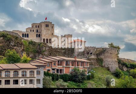 View over the town of Kruja and its fort, in Albania,near Tirana. Kruja castle and Skanderbeg Museum complex on the top of the mountain. - Stock Photo