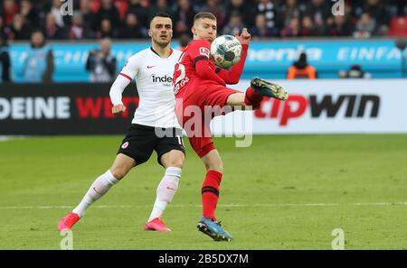 firo: 07.03.2020, Fuvuball, 2019/2020, 1.Bundesliga: Bayer Leverkusen - Eintracht Frankfurt 4: 0 duels, withchell Weiser versus Filip kostic | usage worldwide - Stock Photo