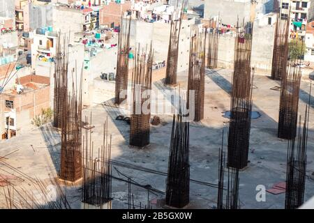 construction worker Concrete pouring during commercial concreting floors of building - Stock Photo