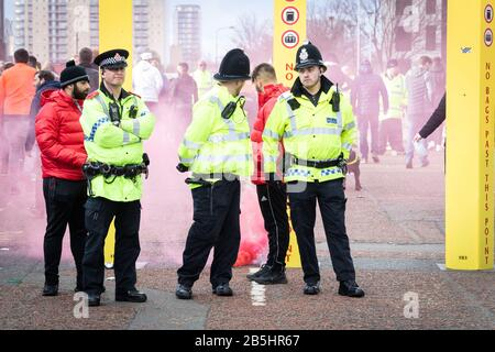 Manchester, UK. 08th Mar, 2020. The second derby of the season sees Manchester City away at Old Trafford where supporters have been gathering since early afternoon. Credit: Andy Barton/Alamy Live News - Stock Photo