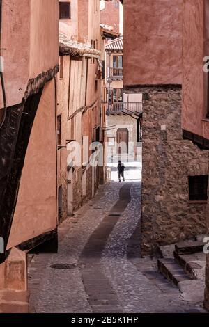 Narrow street or alleyway in the medieval hilltop town of Albarracin near Teruel in the Aragon region of Spain.
