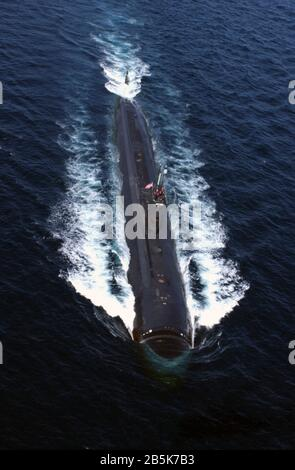The U.S. Navy Los Angeles-class nuclear-powered attack submarine USS Albany underway on the surface March 25, 2004 in Gulf of Oman. - Stock Photo