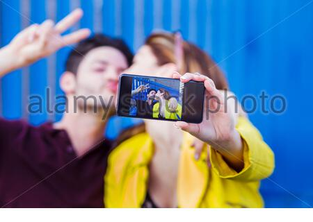 happy young couple in love takes selfie, selective focus - Stock Photo