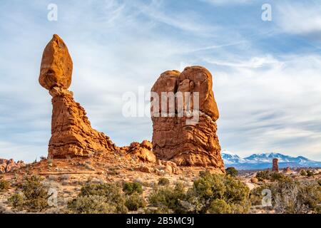 Balanced Rock towering over the desert landscape in Arches National Park in Moab, Utah USA.