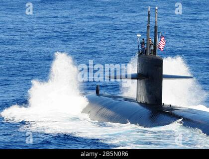 The U.S. Navy Los Angeles-class nuclear-powered attack submarine USS Houston underway on the surface during exercise Keen Sword 2011 December 10, 2010 in the Pacific Ocean. - Stock Photo