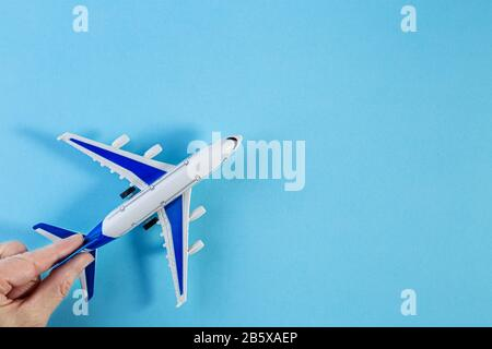Model plane, airplane on blue pastel color background. Flat lay of miniature toy airplane. minimal trip and travel creative concepts. copy space - Stock Photo