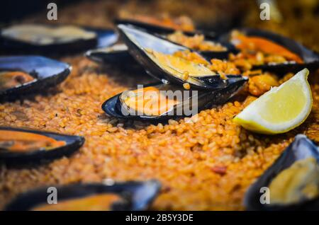 spanish paella dish with fresh seafood & vegetables - Stock Photo
