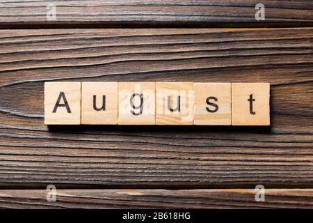 August word written on wood block. August text on wooden table for your desing, Top view concept. - Stock Photo