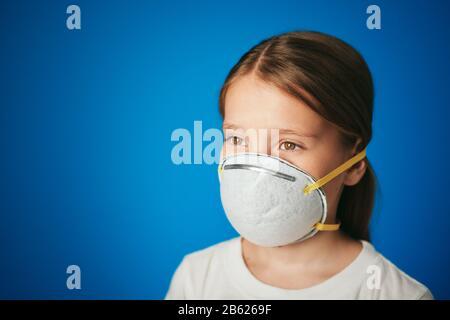 Little White Girl Using Protective Face Mask Against Virus - Stock Photo