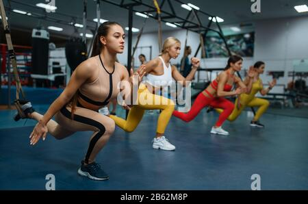 Women doing stretching exercise in sport club - Stock Photo