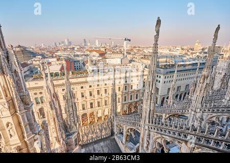 Milan, Italy - January 21 2019: Amazing view of old Gothic spires. Milan Cathedral roof on sunny day, Italy. Milan Cathedral or Duomo di Milano is top