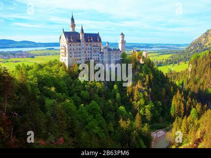 famous bavarian Neuschwanstein Castle situated on the mountains - Stock Photo