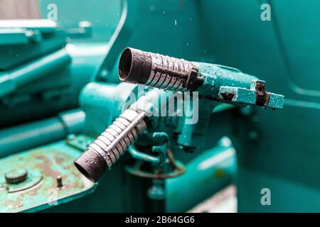 Military green background with artillery mechanism