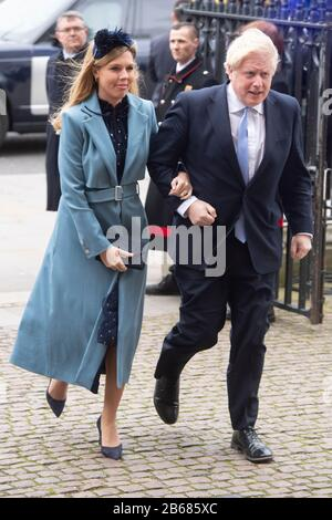 London, Britain. 9th Mar, 2020. British Prime Minister Boris Johnson (R) and his partner Carrie Symonds arrive at the Westminster Abbey to attend the annual Commonwealth Service on Commonwealth Day in London, Britain, March 9, 2020. Credit: Ray Tang/Xinhua/Alamy Live News - Stock Photo