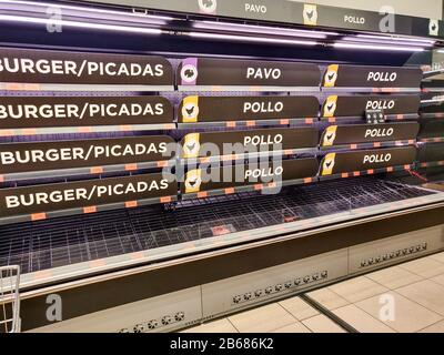 View of empty meat products shelves in a supermaket in Madrid, Spain, 10 March 2020. The Spanish Supermarket Chains Association called for calm after a bigger influx of consumers reached the markets lastest hours. A total of 1,200 people are confirmed to be infected with coronavirus in Spain, so far, 30 of them died due to the virus.EFE/Rodrigo Jimenez