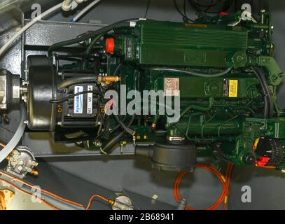 Looking down into the engine bay at a new Hybrid Marine unit fitted to a new diesel engine fitted in a narrowboat on the UK waterways. - Stock Photo