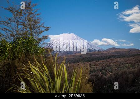 Mount Ngauruhoe in the Tongariro National Park, New Zealand taken at night illuminated by moonlight from the Skotel Alpine Resort - Stock Photo