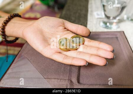 Turkish lira coins as tips in restaurant - Stock Photo