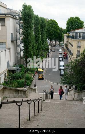People walking on the steep Rue de la Manutention connecting River Seine and Avenue du President Wilson in 16th arrondissement.Paris.France - Stock Photo