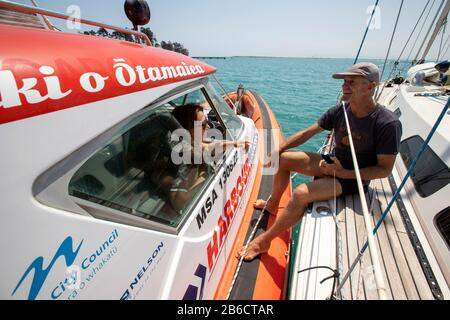 Port Nelson deputy harbourmaster Amanda Kerr on the waters off Port Nelson, Nelson, New Zealand - Stock Photo
