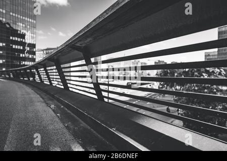 Detail of a flyover railing in black and white - Stock Photo