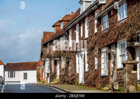 The Grade II listed eighteenth-century Church Hill House, on the far right, and other buildings on Church Hill next to the parish church. - Stock Photo