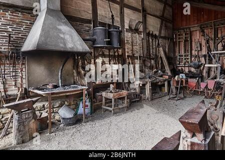 France, Ain departement, Auvergne - Rhone - Alpes région. Ecomuseum Country House in Saint-Etienne-du-Bois. This old wrought installed in an old half-timbered barn and incorpored in the museum.