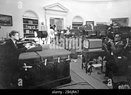 CUBAN MISSILE CRISIS October 1962. US President John F. Kennedy with reporters in the White House during a televised speech to the nation about the blockade of Cuba, 24 October 1962.