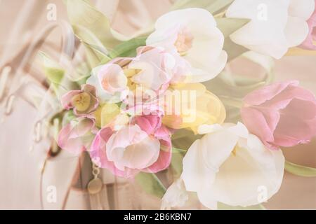 Blurred floral background, double exposure, colorful tulips. Concept of spring, holidays and gifts