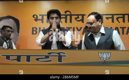 India. 11th Mar, 2020. Jyotiraditya Scindia, former Congress party leader stands with his hands folded to greet with Bharatiya Janata Party (BJP) chief Jagat Prakash Nadda during a press conference where he joined the BJP, in New Delhi, India (Photo by Sondeep Shankar/Pacific Press) Credit: Pacific Press Agency/Alamy Live News - Stock Photo