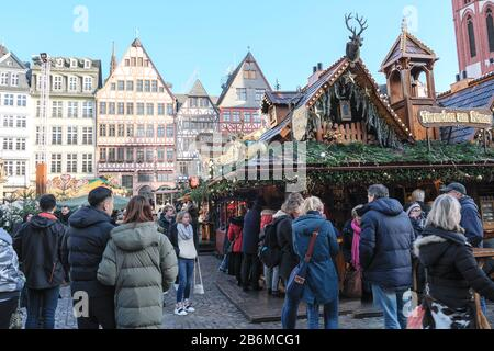 Europe, Germany , Frankfurt Christmas market in the new old town, many visitors enjoy, old half-timbered houses at the Römer, New Frankfurt Old Town - Stock Photo