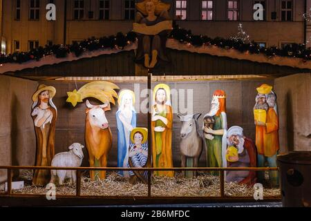 Christmas Manger scene with figurines including Jesus and other biblical characters - Stock Photo