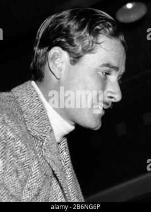 Vintage photo of Australian-born movie star Errol Flynn (1909 – 1959). The photo by Harris & Ewing was taken on January 25 1939 at a horseshow held at Fort Myer, Virginia, as part of birthday celebrations for President Franklin D Roosevelt. - Stock Photo
