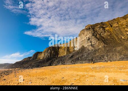 Charmouth, Dorset, UK.  11th March 2020.  UK Weather.  Glorious spring sunshine at Charmouth beach in Dorset with the fossil rich cliffs of Stonebarrow showing many landslips from the recent wet stormy weather.  Picture Credit: Graham Hunt/Alamy Live News - Stock Photo