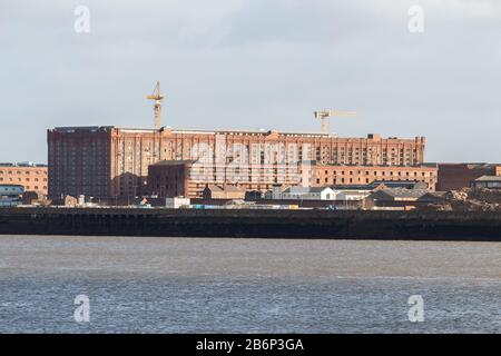 Stanley Dock Tobacco Warehouse, the world's largest brick warehouse, overlooking river Mersey, Liverpool - Stock Photo