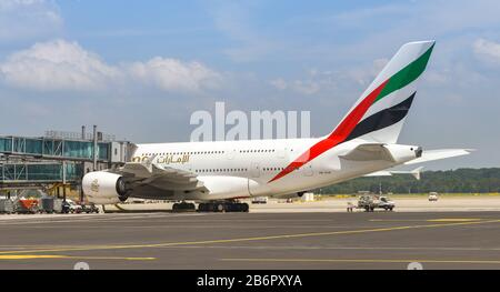 MILAN, ITALY - JUNE 2019: Panoramic view of an Airbus A380 'Super jumbo' jet operated by Emirates on stand at Milan Malpensa airport. - Stock Photo