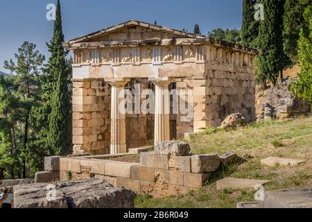Reconstructed Athenian Treasury with doric columns and stone block construction at Delphi in Greece. - Stock Photo