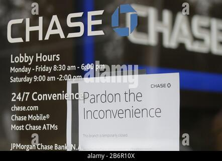 New York, United States. 11th Mar, 2020. A closed sign hangs on the window of a Chase Bank in New Rochelle, NY on Wednesday, March 11, 2020. A 1-mile containment zone around New Rochelle in Westchester County will be set up in hopes of slowing down the spread of the coronavirus, which causes COVID-19. Photo by John Angelillo/UPI Credit: UPI/Alamy Live News - Stock Photo