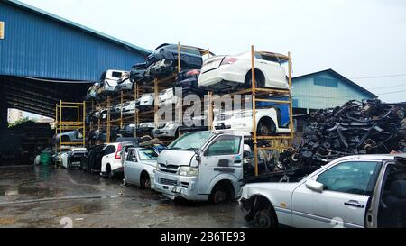 Used asian car parts store in Kuala lumpur. Shelves with disassebled cars. - Stock Photo