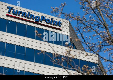 A logo sign outside of the headquarters of TurningPoint Global Solutions in Rockville, Maryland on March 8, 2020. - Stock Photo