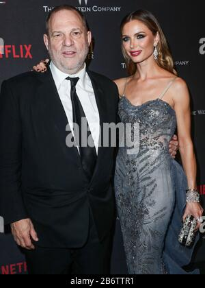 (FILE) 11th Mar 2020. Harvey Weinstein Sentenced to 23 Years in Prison. Harvey Weinstein will spend 23 years in a New York State prison after being sentenced by Supreme Court Judge James Burke on the morning of Wednesday, March 11, 2020. In pic: BEVERLY Hills.LES, CALIFORNIA, USA - JAN 08: Harvey Weinstein and wife/fashion designer Georgina Chapman arrive at The Weinstein Company and Netflix Golden Globe Party, presented with FIJI Water, Grey Goose Vodka, Lindt Chocolate, and Moroccan Oil held at The Beverly Hilton Hotel on Jan 8, 2017. Credit: Image Press Agency/Alamy Live News - Stock Photo