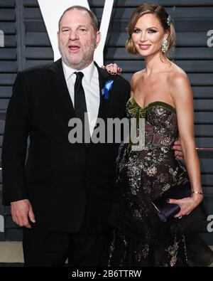(FILE) 11th Mar 2020. Harvey Weinstein Sentenced to 23 Years in Prison. Harvey Weinstein will spend 23 years in a New York State prison after being sentenced by Supreme Court Judge James Burke on the morning of Wednesday, March 11, 2020. In pic: BEVERLY Hills.LES, CALIFORNIA, USA - FEBRUARY 26: Harvey Weinstein and wife/fashion designer Georgina Chapman arrive at the 2017 Vanity Fair Oscar Party held at the Wallis Annenberg Center for the Performing Arts on February 26, 2017 in Beverly Hills.les, California, United States. Credit: Image Press Agency/Alamy Live News - Stock Photo